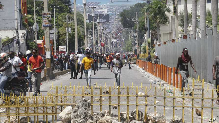 Protesters set up barricades in the street during a protest to demand the resignation of president Jovenel Moise in Port-au-Prince, Haiti, Sept. 27, 2019.
