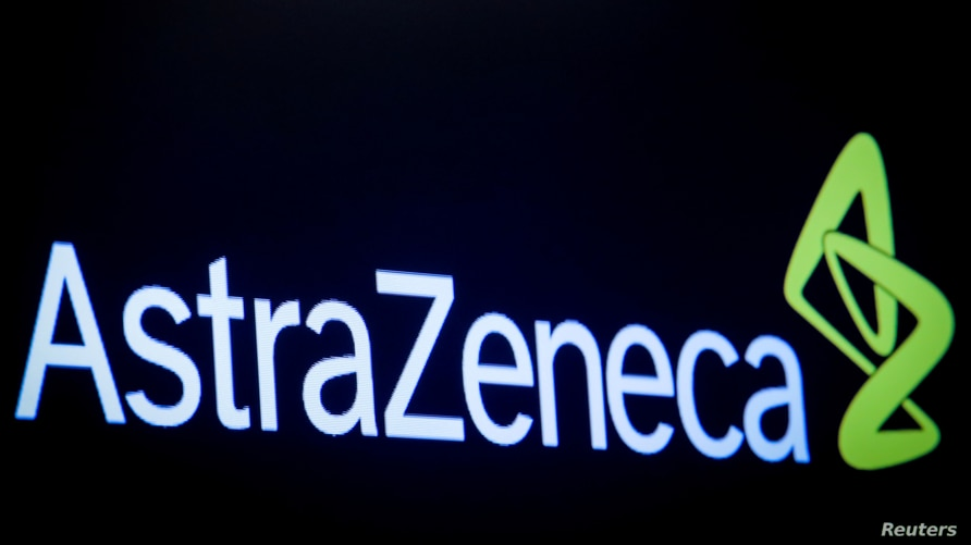 FILE PHOTO: The company logo for pharmaceutical company AstraZeneca is displayed on a screen on the floor at the New York Stock…