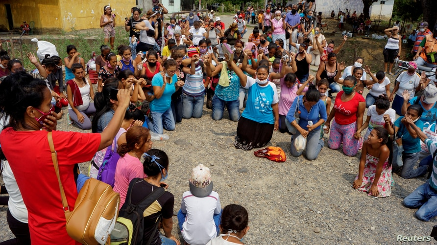 FILE PHOTO: Relatives of inmates pray outside Los Llanos penitentiary after a riot erupted inside the prison leaving dozens of…
