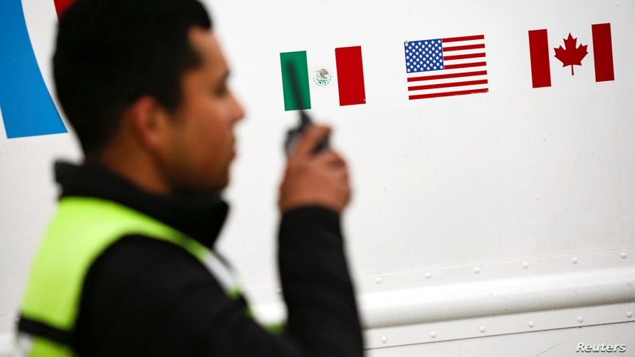 Flags of Mexico, United States and Canada are pictured at a security booth at Zaragoza-Ysleta border crossing bridge, in Ciudad…