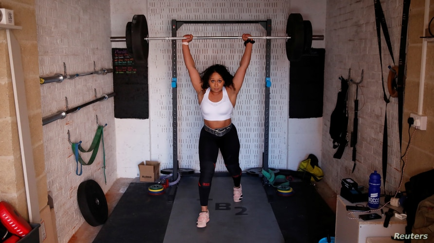 Team GB Weightlifter, Zoe Smith during a training session in a garage, following the outbreak of the coronavirus disease (COVID…