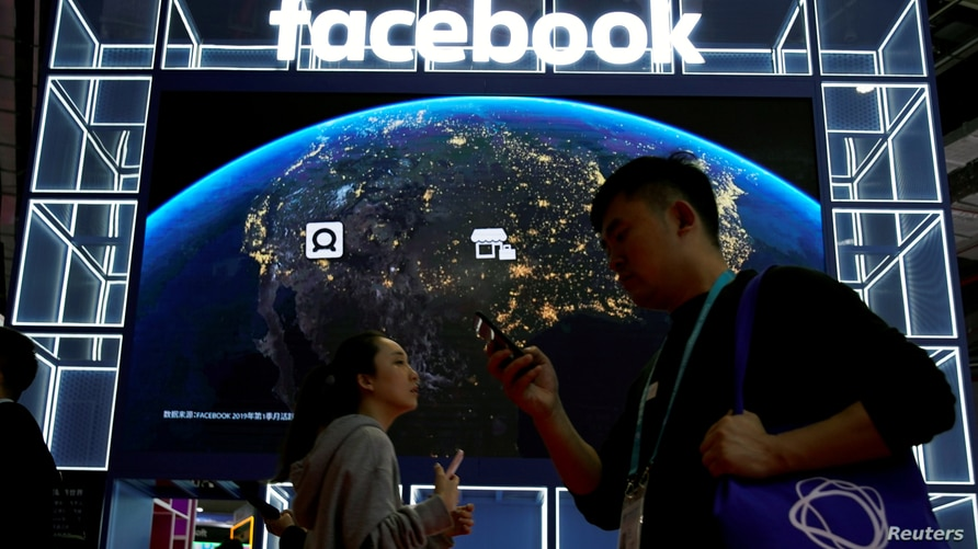 FILE PHOTO: A Facebook sign is seen at the second China International Import Expo (CIIE) in Shanghai, China November 6, 2019…