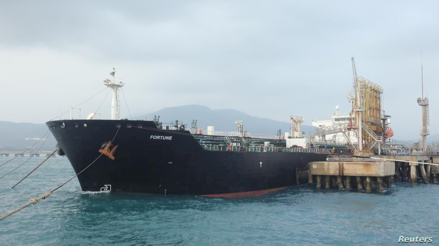 """FILE PHOTO: The Iranian tanker ship """"Fortune"""" is seen at El Palito refinery dock in Puerto Cabello, Venezuela May 25, 2020…"""