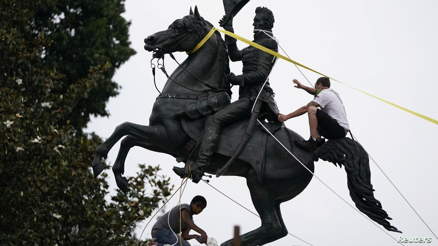 Protestors try to pull down the statue of U.S. President Andrew Jackson in the middle of Lafayette Park in front of the White…