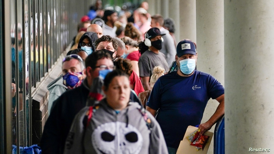 FILE PHOTO: Hundreds of people line up outside a Kentucky Career Center hoping to find assistance with their unemployment claim…