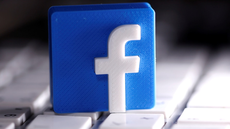FILE PHOTO: A 3D-printed Facebook logo is seen placed on a keyboard in this illustration taken March 25, 2020. REUTERS/Dado…