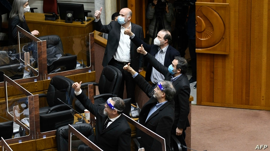 Senators give the thumbs up as they vote a bill that allows the early wihdrawal of private pension funds in Valparaiso, Chile…