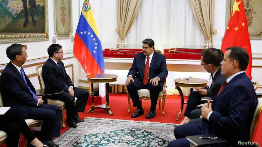 Venezuela's President Nicolas Maduro takes part in a meeting with Zhao Bentang, director-general of the Department of Latin…