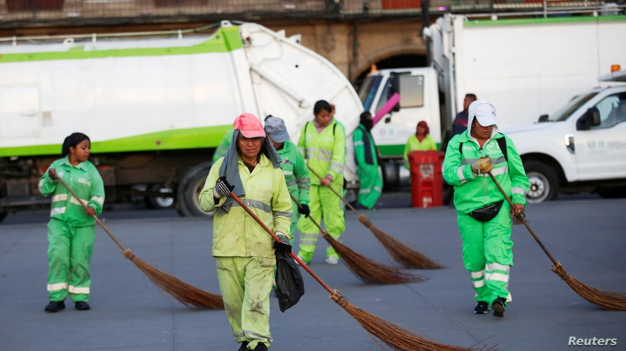 Female sanitation workers swipe the Zocalo square in downtown Mexico City, Mexico March 9, 2020. REUTERS/Gustavo Graf