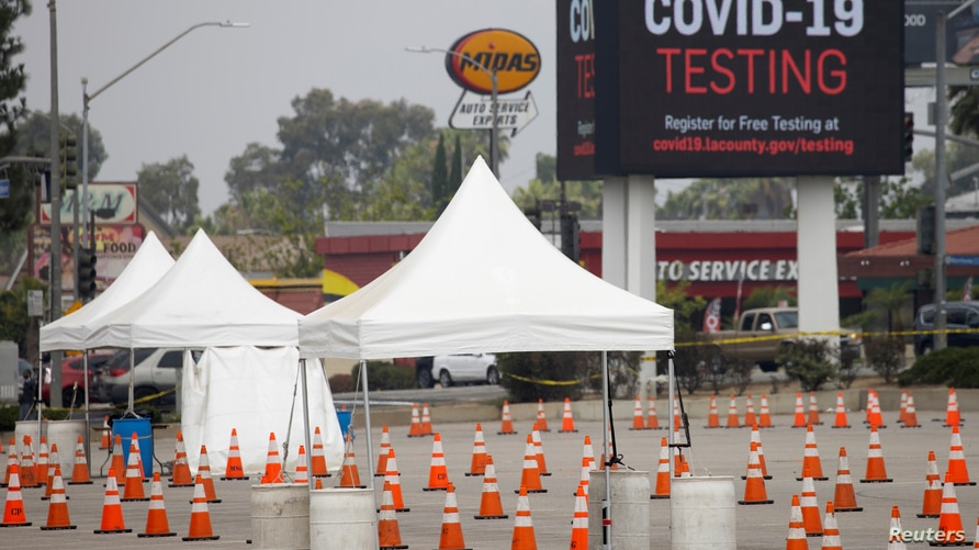 A drive-in COVID-19 testing center is shown empty and abandoned as Los Angeles reports spike in positive tests amid the…