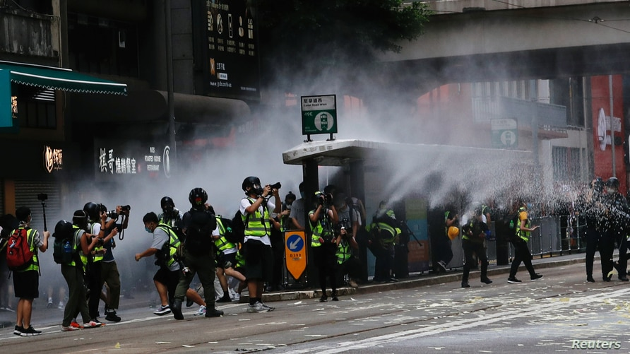 Riot police use water cannon to disperse anti-national security law protesters during a march at the anniversary of Hong Kong's…