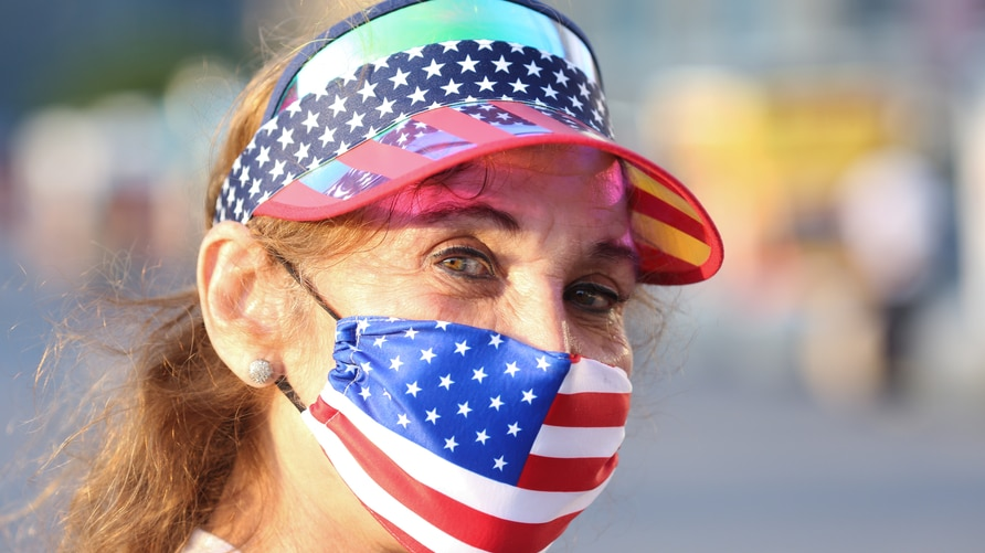 A woman wears a patriotic mask in celebration of the fourth of July at Gantry Plaza State Park in Long Island City, New York, U…