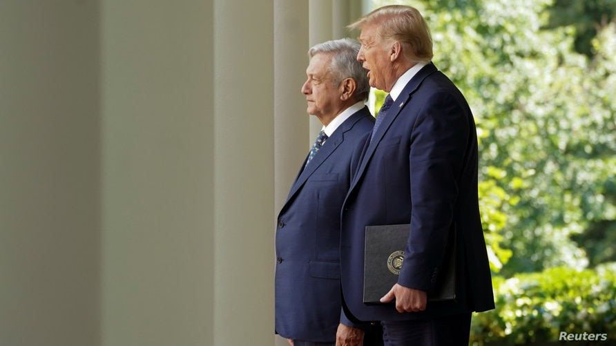 U.S. President Donald Trump leads Mexico's President Andres Manuel Lopez Obrador down the West Wing colonnade to a signing…
