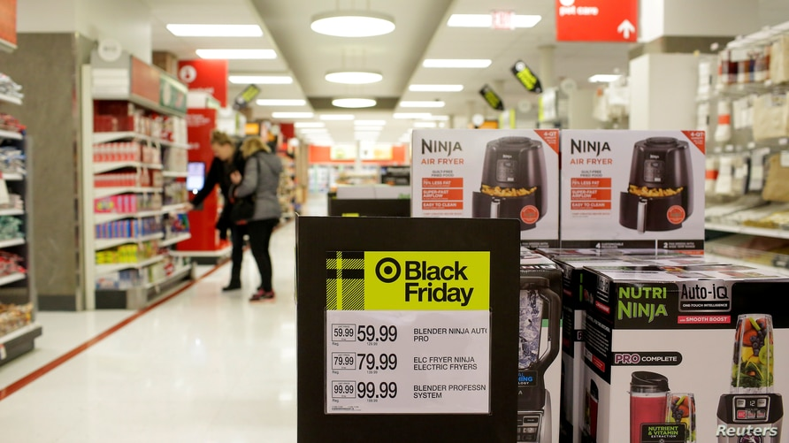 FILE PHOTO: Customers shop during Black Friday sales soon after at a Target store opened for the day in Chicago, Illinois, U.S…