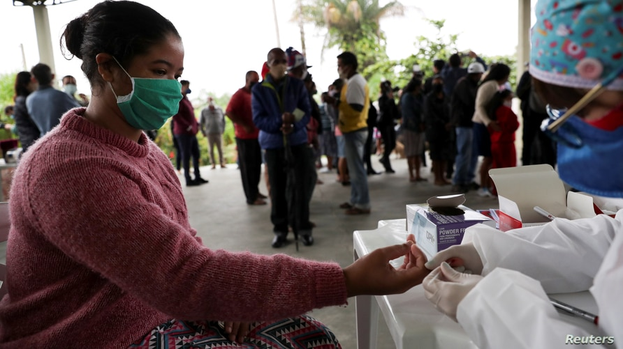 Juliana Cabral, 22, gets tested for the coronavirus disease (COVID-19) by Butantan Institute in Quilombo Peropava, an afro…