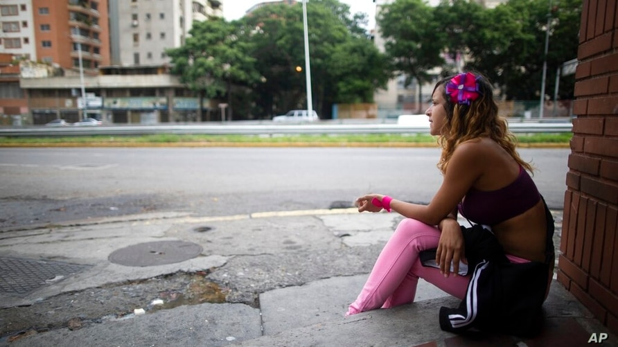 A sex worker who did not want to give her name waits for clients in Caracas, Venezuela, Thursday, June 11, 2020. The 24-year…