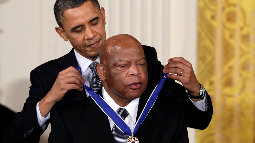 FILE - In this Feb. 15, 2011, file photo, President Barack Obama presents a 2010 Presidential Medal of Freedom to U.S. Rep…