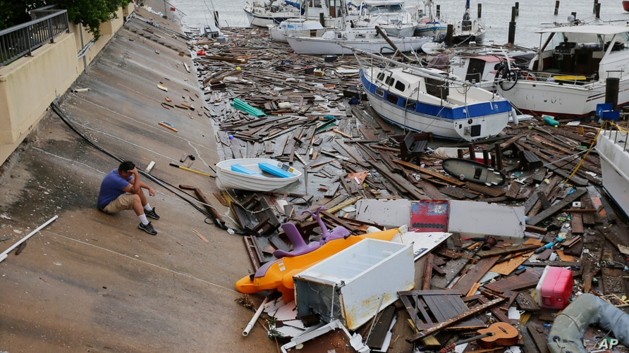 Allen Heath surveys the damage to a private marina after it was hit by Hurricane Hanna, Sunday, July 26, 2020, in Corpus…