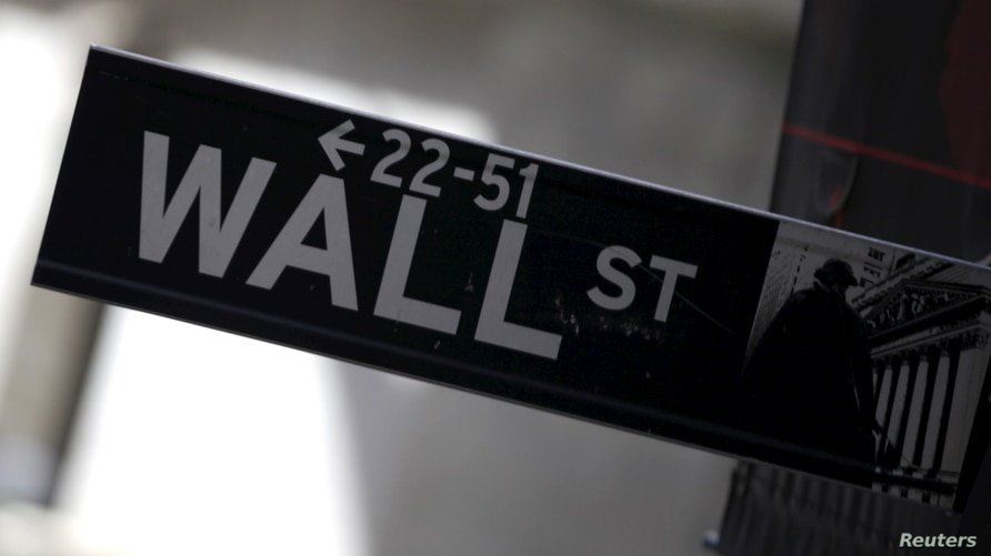 A Wall Street sign is seen in Lower Manhattan in New York, January 20, 2016. Wall Street moved deep into the red on Wednesday,…