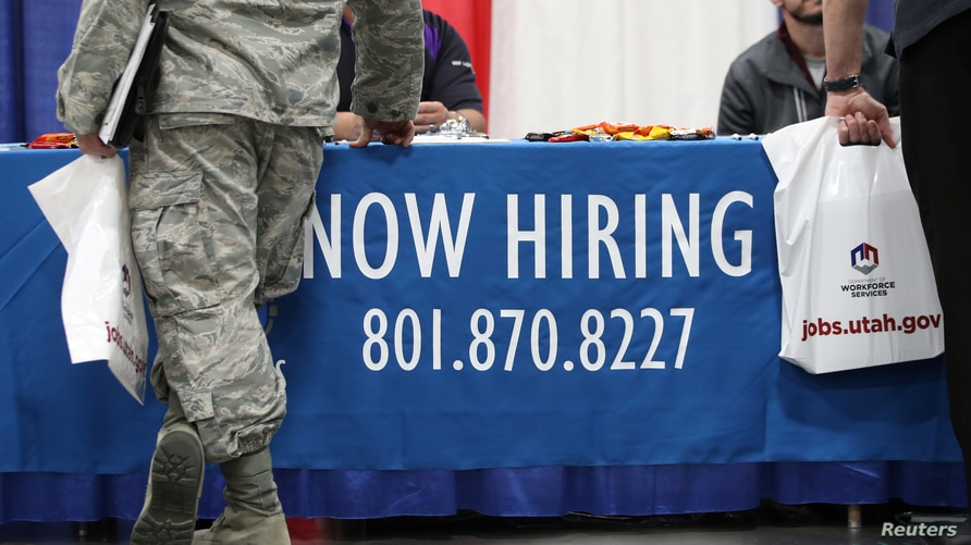 Veterans and military personnel discuss job opportunities at a military job fair in Sandy, Utah, U.S., March 26, 2019.  REUTERS…
