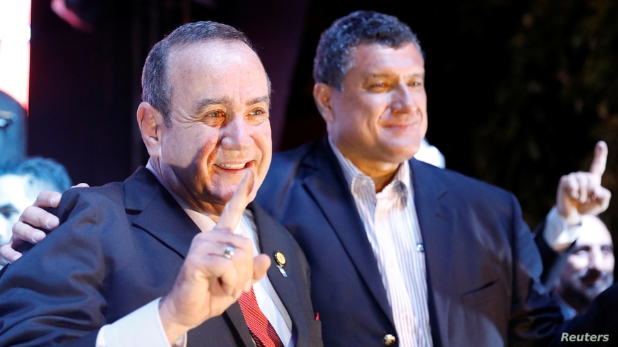 """Alejandro Giammattei, presidential candidate for the """"Vamos"""" political party, gestures with his running mate Guillermo Castillo…"""