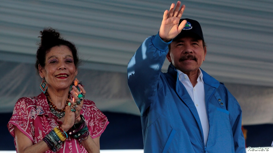 Nicaragua's President Daniel Ortega and Vice President Rosario Murillo greet supporters during an event to commemorate the 40th…