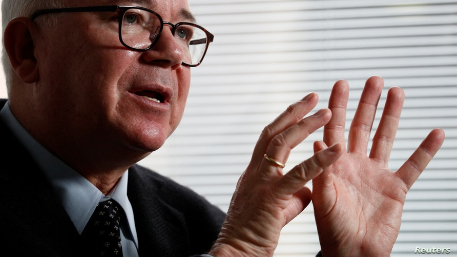 Former Venezuela's Oil and Energy Minister Rafael Ramirez gestures as he speaks during an interview with Reuters at an…