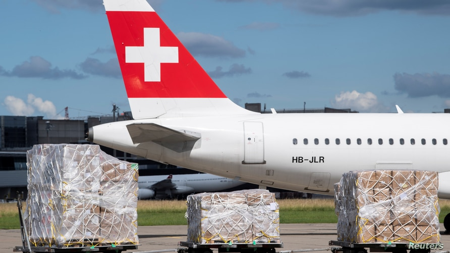 "Tons of relief supplies of the ""Humanitarian Help of Switzerland"" wait at the Zurich Airport to be loaded onto a cargo plane…"