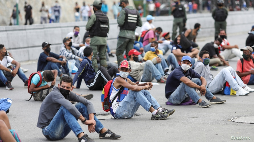 People are placed in the middle of the street by security forces in the low income neighbourhood of Petare as a punishment for…