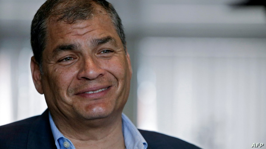 (FILES) In this file photo taken on July 04, 2018 former Ecuadorian President (2007-2017) Rafael Correa speaks during an…