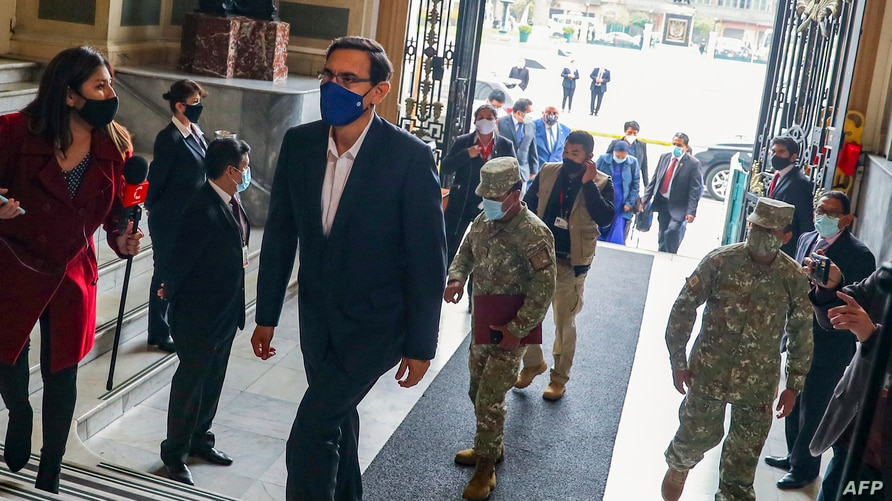 Handout picture released by the Peruvian Presidency showing President Martin Vizcarra arriving to give a statement in Congress…