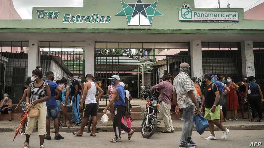 People queue to buy food at a store in Havana, on September 15, 2020. - With the return of the dollar to the island's economy,…