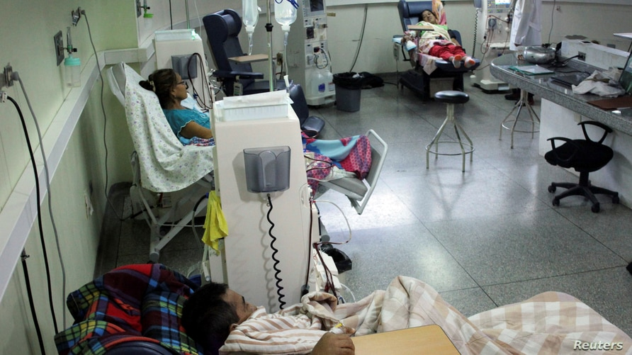 Kidney disease patients receive treatment at a hospital, whose power is supplied by generators, during a blackout in San…