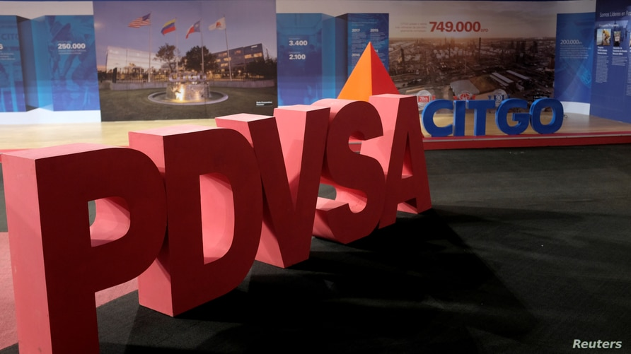 FILE PHOTO: The corporate logos of the state oil company PDVSA and Citgo Petroleum Corp are seen in Caracas, Venezuela April 30…