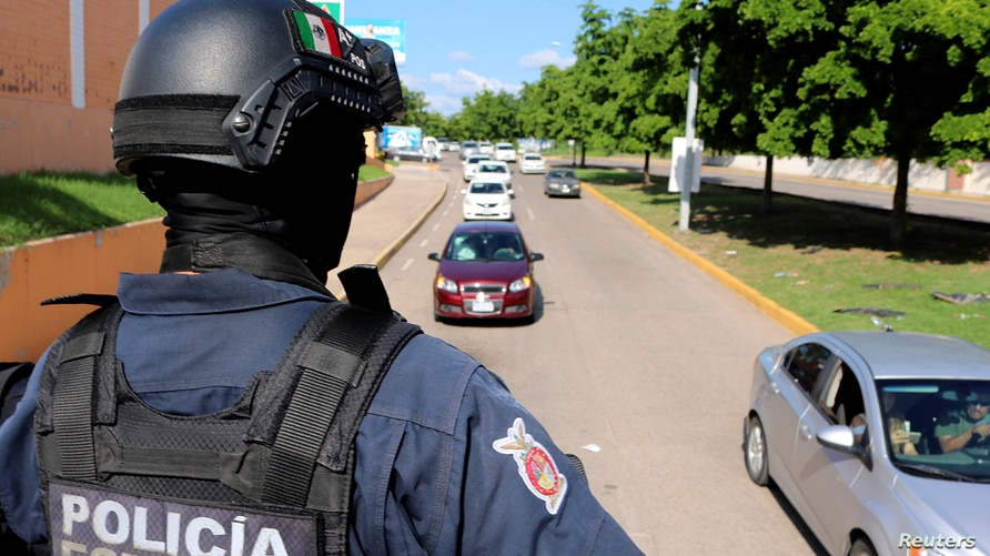 A member of the State Police takes part in a patrol as part of an operation to increase security after cartel gunmen clashed…