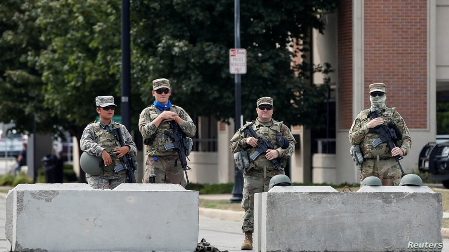 Members of the Wisconsin National Guard stand outside Kenosha County Public Safety Building, over a week since Black man Jacob…