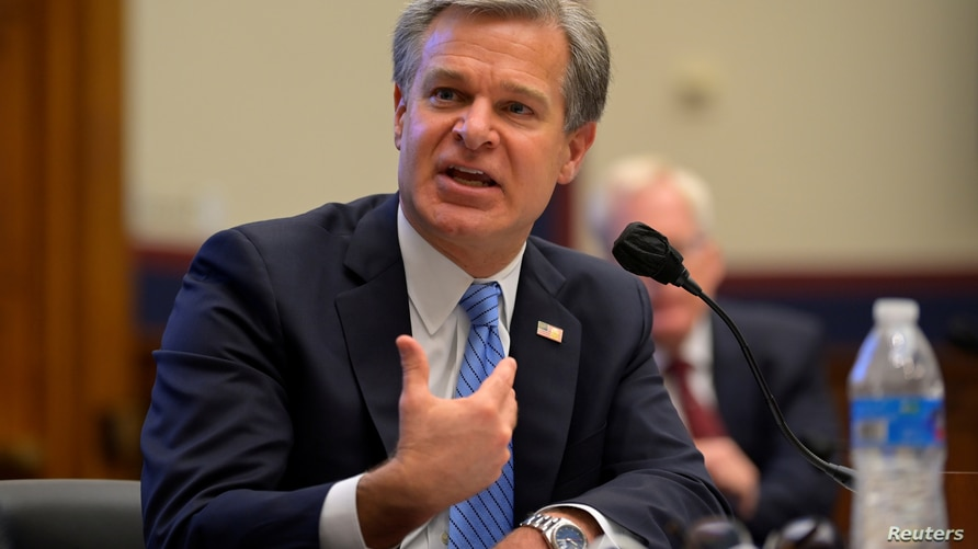 FBI director Christopher Wray testifies during a hearing about 'worldwide threats to the homeland' in the Rayburn House Office…