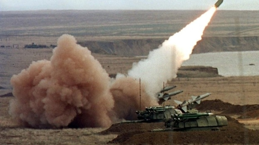 """FILE - A """"Buk"""" anti-aircraft battery launches a ground-to-air missile during the Ukrainian army's """"Duel-99"""" military maneuvers at the Chauda firing ground in the Crimean peninsula, October 12, 2019."""