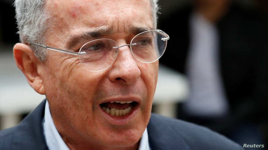 Colombia's former president Alvaro Uribe Velez speaks to the news media after casting his vote at a polling station, during the…