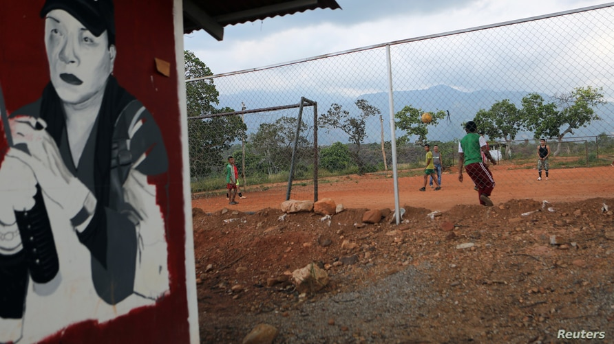 Former rebels of the Revolutionary Armed Forces of Colombia (FARC), play football at a reintegration camp in Tierra Grata,…