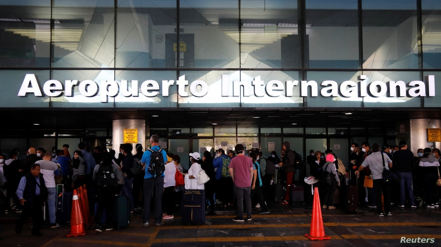 Travelers wait for a charter flight organized by the U.S. embassy, as the coronavirus disease (COVID-19) continues to spread in…