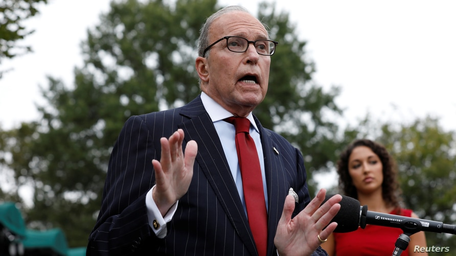 White House economic advisor Larry Kudlow speaks with reporters on the driveway outside the West Wing of the White House in…