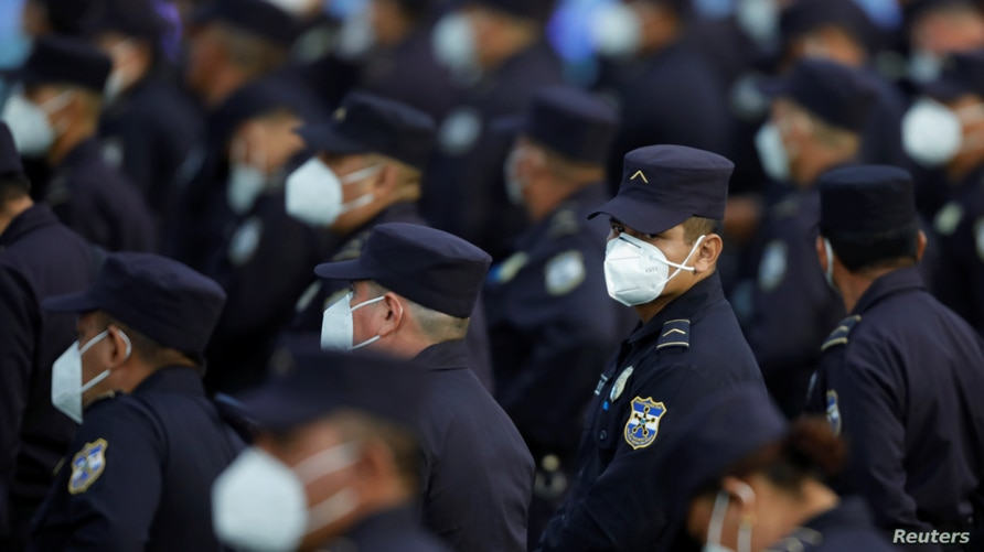 Members of the security forces wearing protective face masks take part in a promotion ceremony from policemen to corporals in…