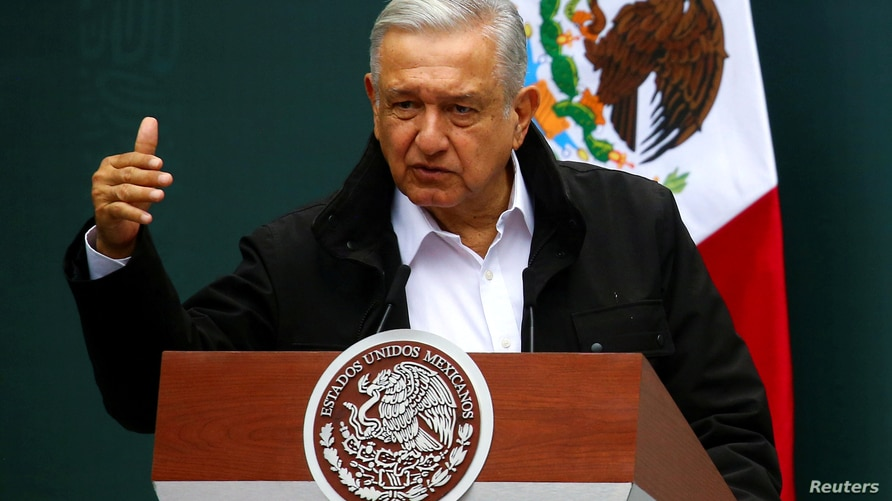 FILE PHOTO: Mexico's President Andres Manuel Lopez Obrador gestures as he speaks during the delivery of an investigation report…