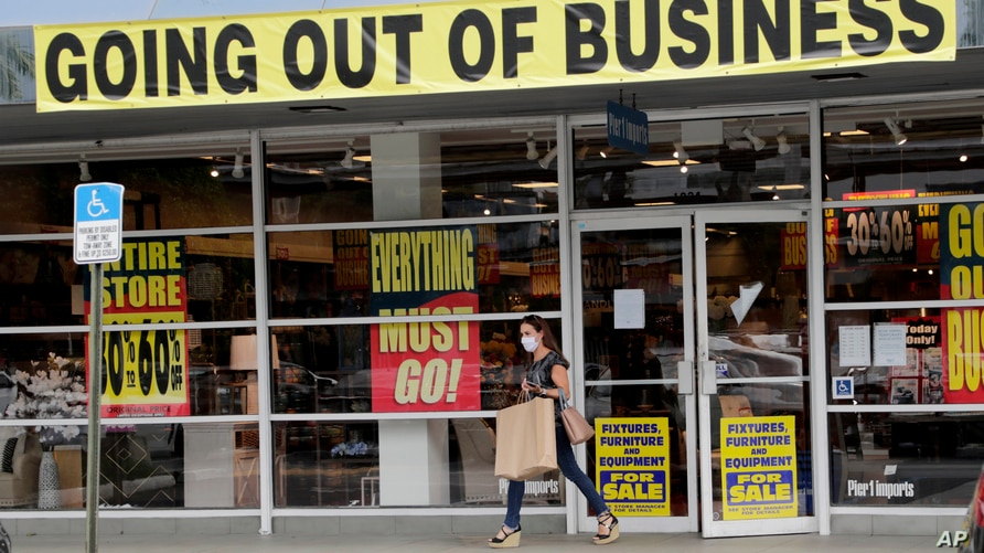 FILE - In this Aug. 6, 2020, file photo, a customer leaves a Pier 1 retail store, which is going out of business, during the…