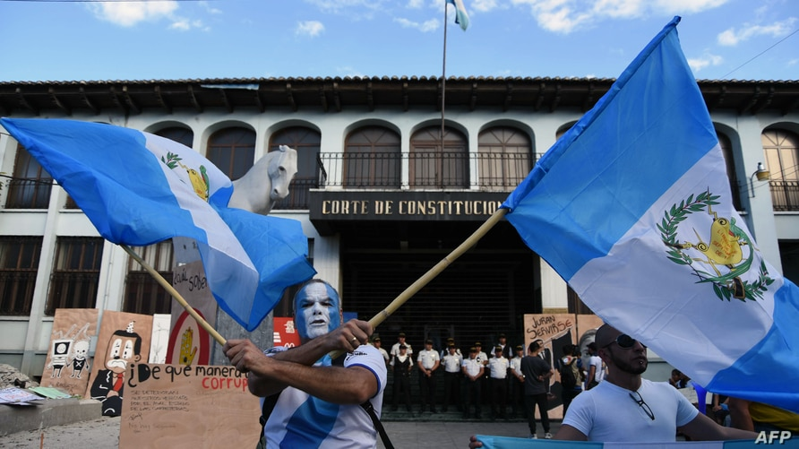 People take part in a demonstration in support of the United Nations International Commission Against Impunity, CICIG, in…