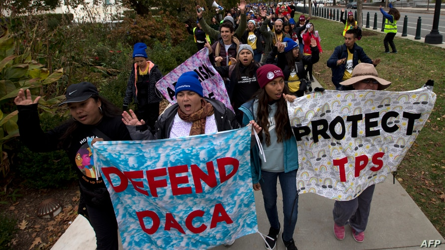 """Demonstrators arrive in front of the US Supreme Court during the """"Home Is Here"""" March for Deferred Action for Childhood…"""