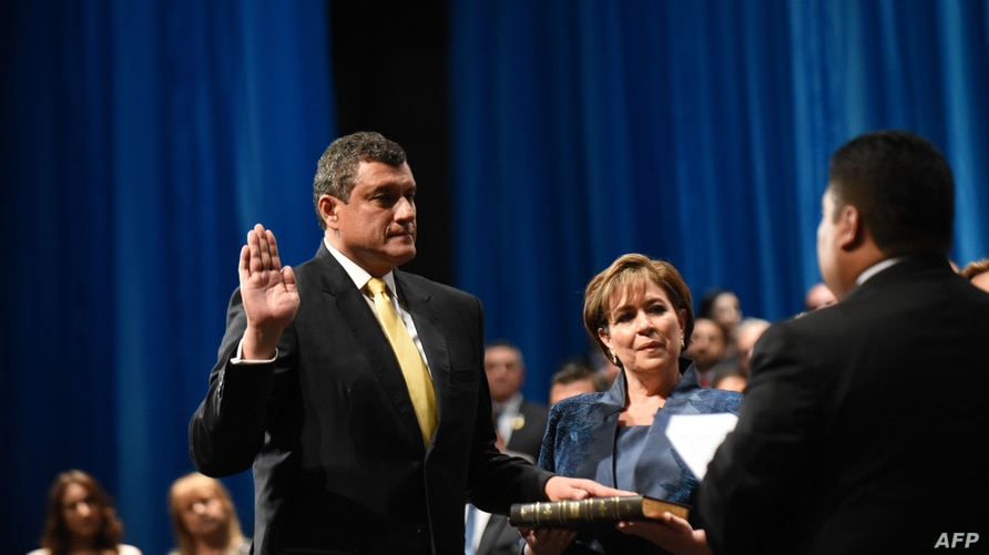 Guatemalan new Vice-President Guillermo Castillo swears in during his inauguration ceremony at the National Theater, in…