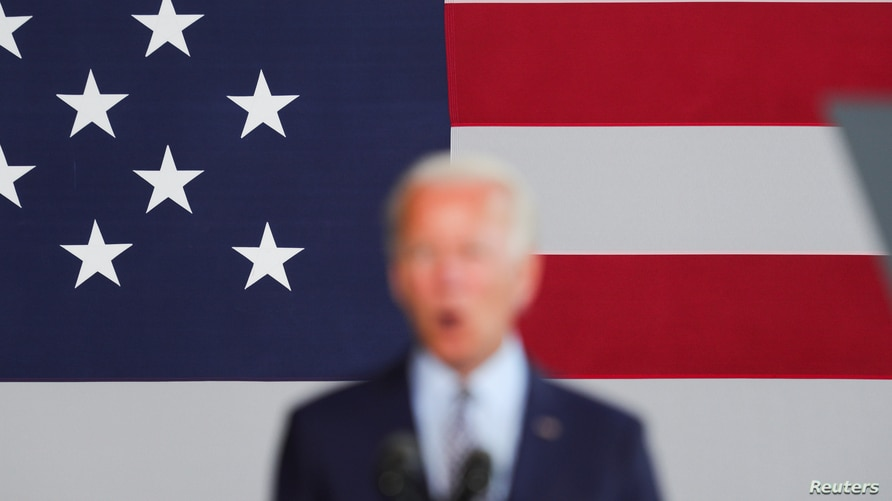 Democratic U.S. presidential candidate and former Vice President Joe Biden speaks about the U.S. economy in front of a large…