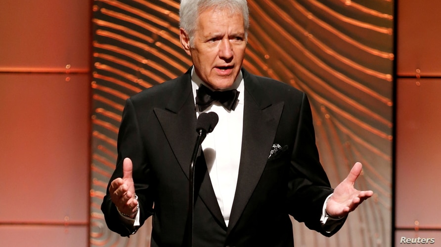 FILE PHOTO: Jeopardy television game show host Alex Trebek speaks on stage during the 40th annual Daytime Emmy Awards in…